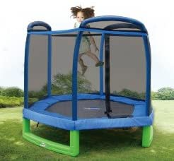 This is an image of Sportspower My First Trampoline With Enclosure. A small kid is jumping happily in the middle.