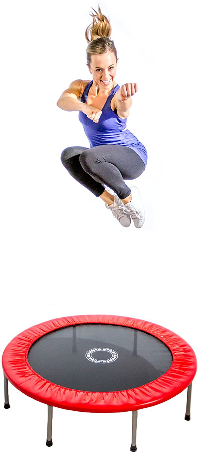 This is an image of Sportspower 48 ″ Mini Trampoline with the red pad. A woman is jumping on it.