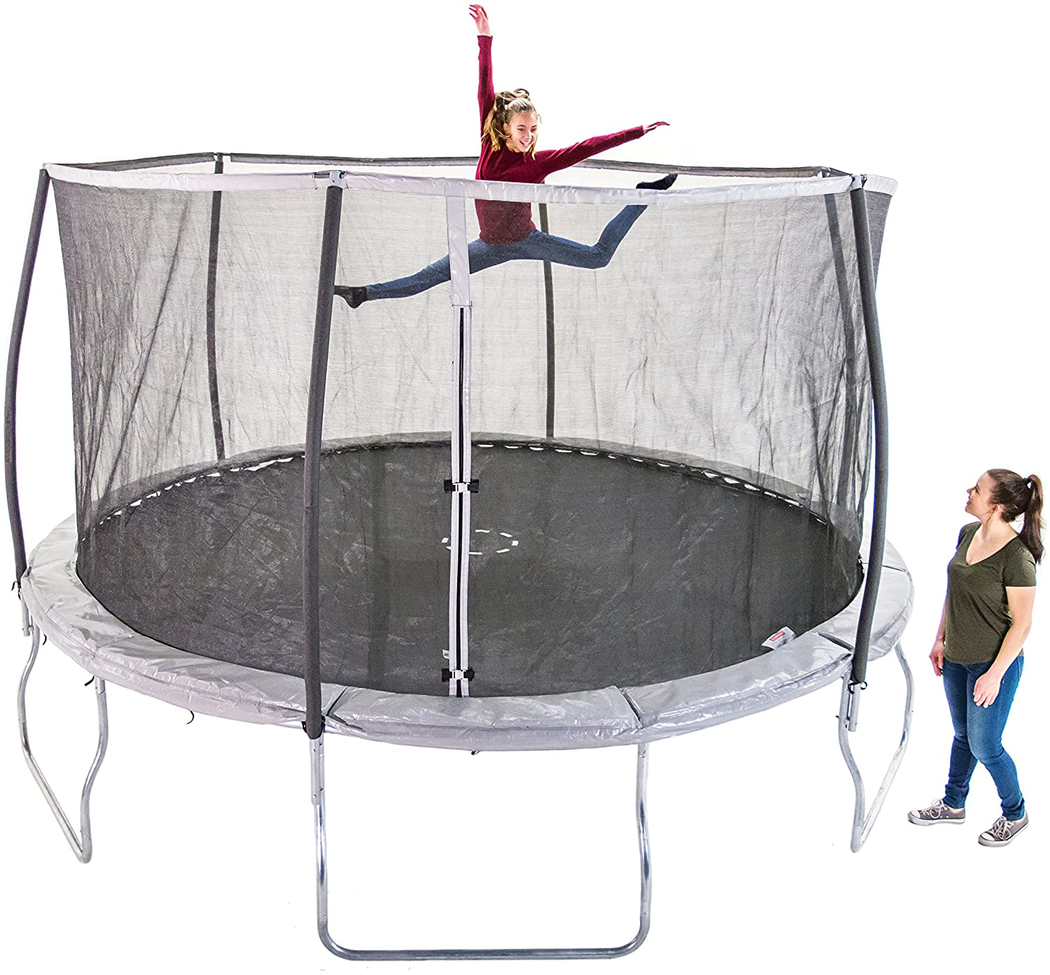 This is Sportspower 14ft Trampoline With Steelflex Unit Net as well as Poles. The young sister is jumping while the mommy is standing aside watching her.